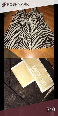 Michael Kors Animal Print Tank Top Medium Brown zebra print tank top.  Has front and back v-neck style.  From Michael Kors. Size medium.  Good condition.  Important:   All items are freshly laundered as applicable prior to shipping (new items and shoes excluded).  Not all my items are from pet/smoke free homes.  Price is reduced to reflect this!   Thank you for looking! Michael Kors Tops Tank Tops