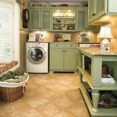 Lattice cupboard doors from Medallion Cabinetry add texture pattern and an open feel while still hiding the cabinet's contents. This country style laundry room has real Southern charm.