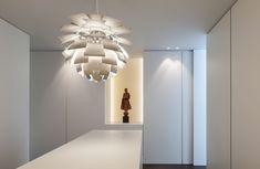 Small niche for art adding a visual accent in a white space. DM residence by Balgian architects Cubyc. Photography by Koen van Damme and Thomas de Bruyne.