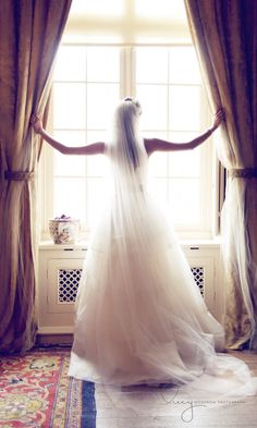 wedding | bride looking out window, gorgeous photo