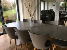 I finally replaced my much loved oak refectory table with this much more suited table with a ceramic top.  The chairs are from made.com.