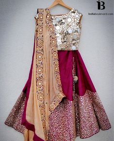 Pretty magenta coloured lehenga teamed with a glitter top and dupatta. Indian fashion.