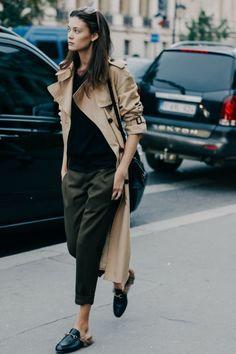 camel trench coat, cropped pants, black top, windbreaker, black flat mules, sunglasses