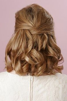 This is a fresh spin on the classic half-up half-down look.