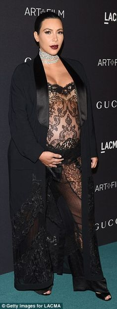 Strike a pose: The wife of rapper Kanye West looked her usual glamorous self as she stole ...