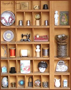 Cabinet of curiosities    I'm in love with tiny sewing items and bisque doll parts, nests amongst many other things that is lol