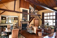 Great room in former carriage house with cathedral ceiling, post and beam construction and tongue and groove paneling.