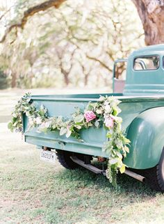 Floral garland on vintage pick up truck.