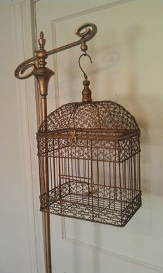 I am not sure why but I have a funny obsession with vintage bird cages. i want one so badly!