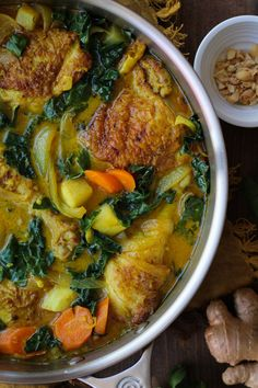 Ginger and Turmeric Braised Chicken with turnips, kale, and carrots in coconut milk broth | TheRoastedRoot.net #healthy #dinner #recipe