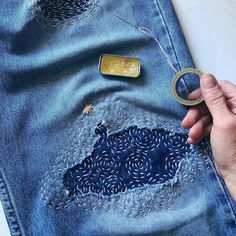 Circles are an easy pattern to mend with. You can use any ring shape, or even a drinking glass to create a circle stencil. Then, stitch… Embroidery On Clothes, Embroidered Clothes, Artisanats Denim, Shashiko Embroidery, Diy Vetement, Japanese Embroidery, Hand Embroidery Designs, Diy Clothing, Sewing Crafts