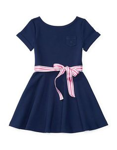 Combining the ease of a tee with a girlie fit-and-flare silhouette, this stretchy pull-on dress will become her go-to for museum trips or birthday parties.  <ul><li>Boatneck</li> <li>Short sleeves with rolled cuffs</li> <li>Chest patch pocket</li> <li>Waist removable striped grosgrain sash tie</li> <li>Pull-on style</li> <li>Polyester/viscose/elastane</li> <li>Machine wash</li> <li>Imported</li></ul>