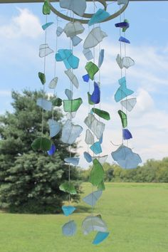 DIY Sea Glass Wind Chimes - would be sturdier from brass rings, but I like the look of white painted wood, nice to hang where it will catch the light - these are perhaps more suncatchers than they are windchimes