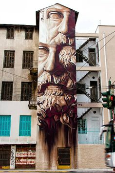 """""""System of a Fraud"""" (portrait of Solon the lawmaker) Street art in Athens, Greece, by iNO."""