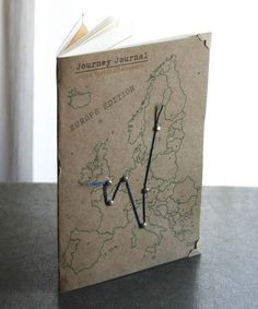 Cracked Designs | The Journey Journal-EUROPE EDITION.  The Journey Journal is your ultimate travel companion! Makes a perfect gift for the traveler in your life!  This awesome journal has it all! It includes pages for official information, a 13 day trip journal, a page for after thoughts and a nifty compartment so you can safely store all the treasures you collect on your trip.