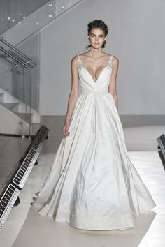 Style 8668  Jim Hjelm by Hayley Paige bridal gown -Ivory Silky Taffeta bridal Ball gown, V-neckline, draped bodice, accented with crystal straps, natural waist, side pockets, scoop back, sweep train