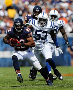 Chicago Bears running back Matt Forte runs past Indianapolis Colts linebacker Kavell Conner in the second quarter at Soldier Field.