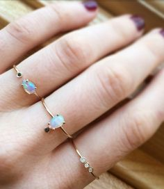 These gorgeous stones are complimented perfectly with these simple, delicate bands.