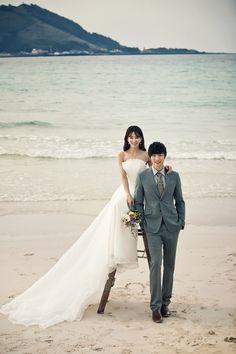 Pre-Wedding at the beach in Jeju Island, Korea by May Studio   www.OneThreeOneFour.com