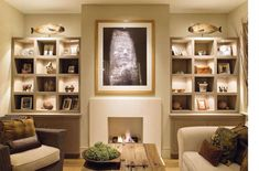 Bookcases flank the fireplace in this modern living room  - Bookcase Feature Wall