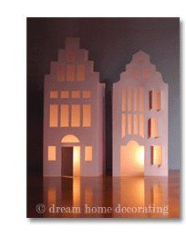 two handmade white paper houses