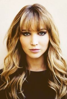The bouncy luscious hairstyle is dressed over the shoulders showing off the medium loose curls added to the mid-lengths to ends for shape that is wonderful for people with long face shapes. The long hairstyle has great layers cut round the sides and back to enhance the great bounce and movement of the bouncy curls[Read the Rest]