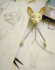 Showing work of building up from wire & drawing by Tireless Artist.  *free tutorials: air dry clay doll armature (no pix) & making a doll corset found on her blog here:  http://tirelessartist-tutorials.blogspot.com/