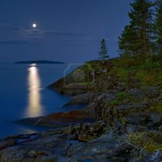 Moonlit night at stony shore of Ladoga lake, Russia