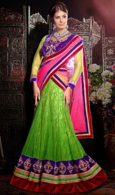 Stand out in the crowd dressed in this lime green net embroidered choli skirt. The beautiful moti, patch, resham and velvet patch work a significant characteristic of this choli. Upon request we can make round front/back neck and short 6 inches sleeves regular choli blouse also. #NewStyleLehengaCholi