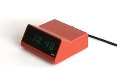 Braun Clock Led DN40 designed by Dieter Rams. The shell wrapping around a screen.