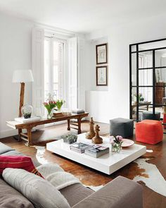 classic-eclectic-living-room-large-chess-pieces-cow-hide-rug-orange-pillows.jpg 575×719 pixels