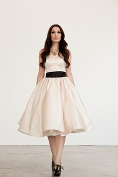 This is the dress I'm thinking of getting but without the black sash… even tho i kind of like the black…?