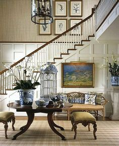What to Hang in a Two-Story Foyer Ordinary wall art is often too small in two-story rooms like foyers; solve this decorating dilemma with one of these large-scale wall art ideas.: Hang a Gallery Wall Foyer Decorating, Interior Decorating, Interior Design, Decorating Ideas, Decorating Bookshelves, Design Entrée, House Design, Design Ideas, Beautiful Interiors