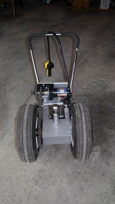 This trailer dolly is built using parts available at Princess Auto (in Canada) and probably Harbour Freight in the US. Parts list: 2000 lb ATV winch 16 tooth drive gear 54 tooth driven gear… Trailer Plans, Trailer Build, Car Trailer, Utility Trailer, Camper Trailers, Campers, Trailer Ramps, Trailer Dolly, Power Trailer