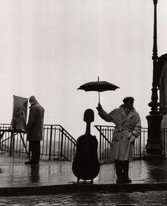 Musician in the Rain, Maurice Baquest, Paris - Robert Doisneau 1957