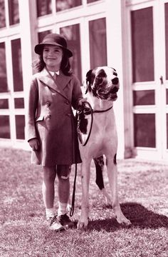 Jacqueline Bouvier with her Great Dane, King Phar, apparently borrowed by her father. (animalfair.com)