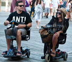 Vinny and Snooki brought their shady style to the shore as they rode around the boardwalk on scooters