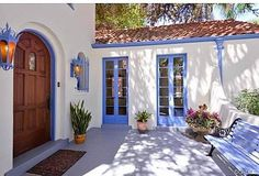 blue kitchen cabinets small infomal style courtyard entrance to a house 12488