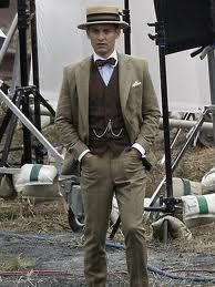 Nick Carraway - Toby Maguires character - dons a straw boater & bow tie for a good part of the film