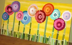 Paint chip flowers...cute spring art project for little ones.