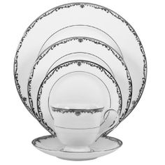 LENOX DINNERWARE CORONET PLATINUM.  Lenox festive tartan china produces entertaining even more festive and what could be more festive than colorful tartan ribbon and bows, fruits and acorns, holly and berries this delicate festive fruit and plaid pattern, with 24-karat gold trim, is dishwasher-safe. Includes: dinner plate, salad plate, butter plate and cup saucer.