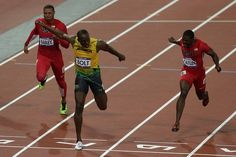 Jamaican Usain Bolt crosses the line first to take gold in the men's 100m final.