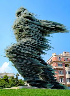 Athens, Greece Dromeas (The Runner Man) Glass Sculpture in Athens, Greece made from stacked plates of glass that connote speed.   It was created in 1994 by Greek sculpture Costas Varotsos and stands in the Hilton square on Vassilissis Sofias Avenue in Athens, Greece.