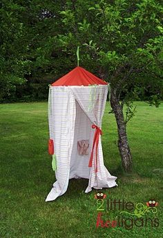 """""""Hula hoop, sheets and ribbons. Why did I never think of using a hula hoop to make forts?"""" - Ooh! This could be like having your very own portable changing room for when you go to the beach and they don't have bathrooms and you don't want to get the car all sandy. Just tie it up to the nearest tree/pole/object and presto!"""