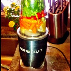 #nutribullet #v8 drink for #dinner - I love the thing! #carrots #cucumber #tomatoes #lemon #spinach #hotsauce #ginger #flaxseed #nutriblast