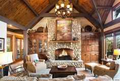 Rustic Living Room with French doors, Exposed beam, stone fireplace, Hardwood floors, Chandelier, High ceiling