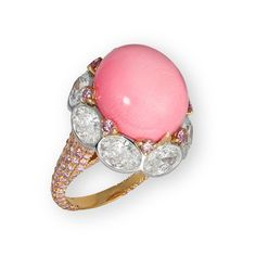 This David Morris ring features a central conch pearl surrounded by oval white diamonds and micro-set pink diamonds.