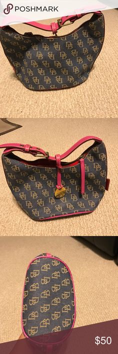 Dooney and Bourke Purse Jean like material with tan DB'S all over. Trim is a pink color. Great condition, like new and rarely used! Smoke free home Dooney & Bourke Bags Shoulder Bags