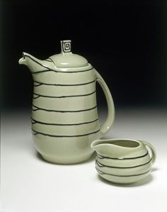Earthenware coffee pot glazed with tube lined decoration, designed by Susie Cooper, made by Wood & Sons Ltd for Susie Cooper Pottery ca.1933 England