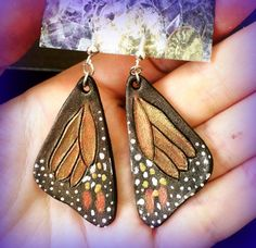 Hand tooled leather iridescent monarch by Gemsplusleather on Etsy
